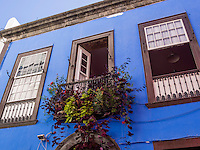 A balcony decorated with flowers at a business and residential house in the shopping street Calle Perez de Brito at Santa Cruz.