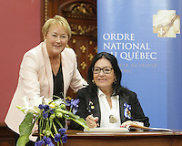 Singer Nana Mouskouri, left, receives the Ordre National du Quebec from Quebec Premier Pauline Marois during a ceremony Tuesday May 28, 2013 at the legislature in Quebec City.