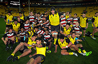 The teams pose for a group photo after the rugby match between the Hurricanes under-18s and Crusaders Knights at Westpac Stadium in Wellington, New Zealand on Saturday, 15 July 2017. Photo: Dave Lintott / lintottphoto.co.nz