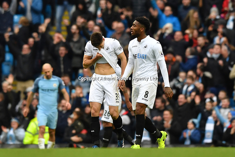 Swansea City's Federico Fernandez and Swansea City's Leroy Fer appear dejected as Manchester City's Gabriel Jesus scores the second goal during the Premier League match between Manchester City and Swansea City at the Etihad Stadium, Manchester, England. Sunday 05 February 2017