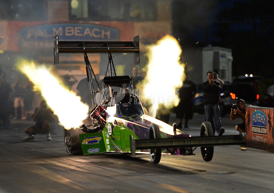 Jan. 17, 2013; Jupiter, FL, USA: NHRA top fuel dragster driver Leah Pruett during testing at the PRO Winter Warmup at Palm Beach International Raceway.  Mandatory Credit: Mark J. Rebilas-