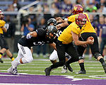 SIOUX FALLS, SD - SEPTEMBER 8: Michael Atonio #31 from the University of Sioux Falls lunges for the legs of quarterback Jake Comeaux #7 from Northern State in the first half of their game Saturday night at Bob Young Field in Sioux Falls. (Photo by Dave Eggen/Inertia)