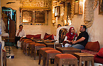 Nestled in the Tunis Medina (old city) is a café, where couples sit quietly to chat as the men smoke tobacco through long glass water pipes called chichas.  The Tunis Medina is a UNESCO World Heritage site.