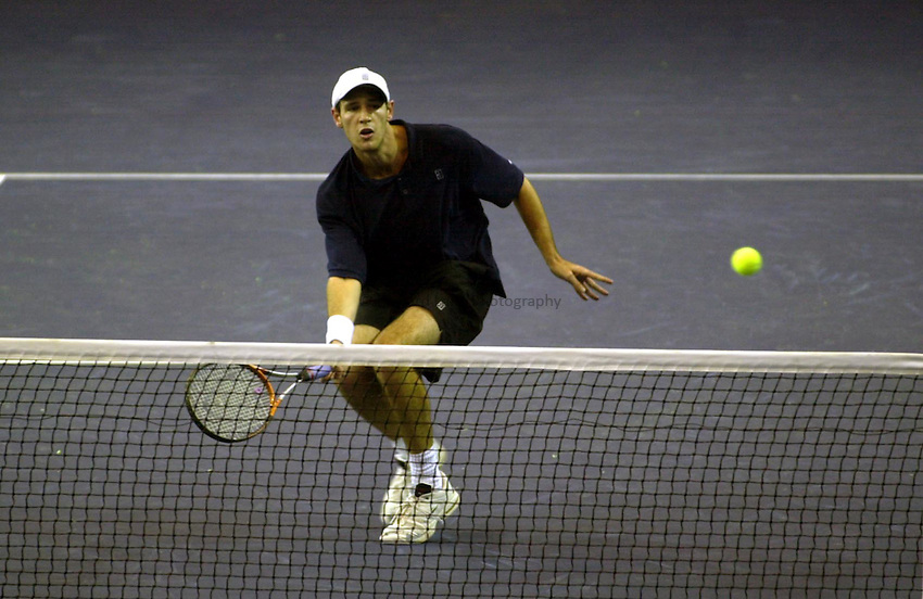 Photo Ken Brown.21.11.00 The Samsung Open.Oliver Freelove GB plays a volley in his defeat at the hands of Diego Nargiso