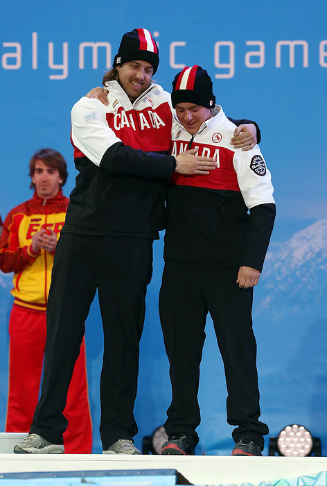 Sochi, Russia, 08/03/2014. Canadian skier Mac Marcoux and guide Robin Femy celebrate their Bronze medal win at the 2014 Paralympic Games in Sochi Russia. Photo(Scott Grant/Canadian Paralympic Committee)