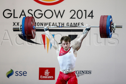 27.07.2014. Glasgow, Scotland. Glasgow 2014 Commonwealth Games Day 4. Weightlifting. Jack Oliver of England in action in the Mens 77kg Final.