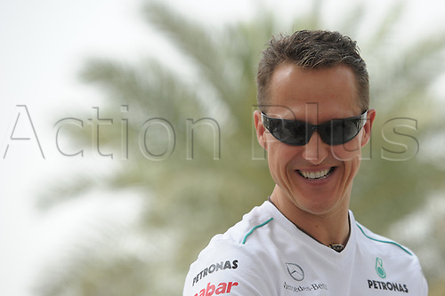 19.04.2012. Bahrain, Persian Gulf.  German Formula One driver Michael Schumacher of Mercedes AMG laughing in the paddock of the Bahrain International Circuit in Sakhir, near Manama, Bahrain, 19 April 2012. The Formula One Grand Prix of Bahrain will take place on 22 April 2012.