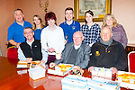 Noreen the house keeper in Killarney Presbytery serves the fish and chips  she won for the Priests in a Radio Kerry/Quinlan's fish shop competition on Good Friday front row l-r: Fr Kieran O'Brien, Fr Pat Horgan, Fr Paddy O'Donoghue. Back row: Liam Quinlan, Krenare Jashari, Brendan Fuller, Suzanne Lynch and Eileen O'Connor