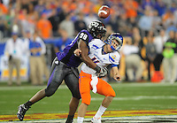Jan. 4, 2010; Glendale, AZ, USA; Boise State Broncos quarterback (11) Kellen Moore is hit by TCU Horned Frogs defensive end (98) Jerry Hughes after throwing the ball away in the second quarter in the 2010 Fiesta Bowl at University of Phoenix Stadium. Mandatory Credit: Mark J. Rebilas-