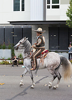 Man wearing sombrero hat riding horse, Kent Cornucopia Days, Kent, Washington State, WA, USA.