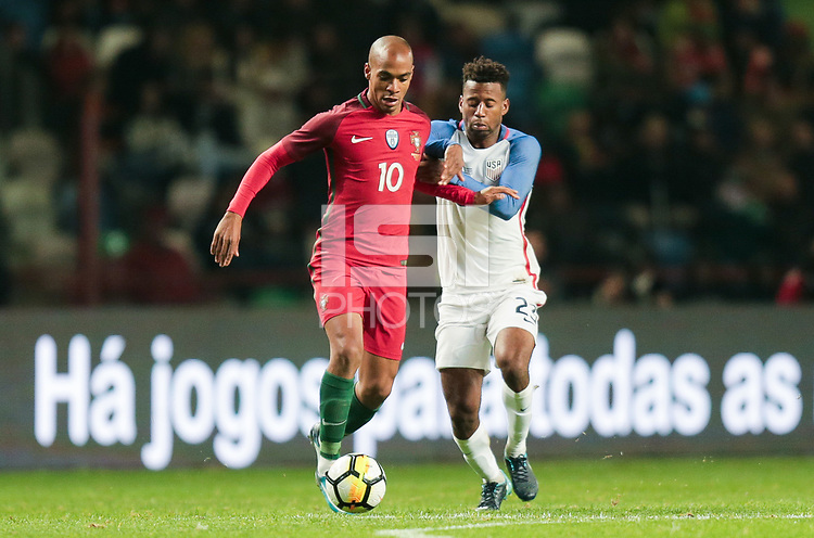 Leiria, Portugal - Tuesday November 14, 2017: João Mário, Kellyn Acosta during an International friendly match between the United States (USA) and Portugal (POR) at Estádio Dr. Magalhães Pessoa.