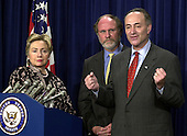 Washington, DC - November 14, 2002 -- United States Senator Hillary Rodham Clinton (Democrat of New York), left, United States Senator Jon Corzine (Democrat of New Jersey), center, look on as United States Senator Chuck Schumer (Democrat of New York), right, answers a reporter's question during a press conference in the United States Capitol in Washington, DC on November 14, 2002. The 3 senators called for the inclusion of a 9/11 Investigative Commission in the Homeland Security Bill. .Credit: Ron Sachs / CNP