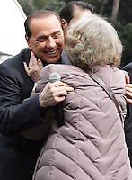 Il leader del Popolo della Liberta' Silvio Berlusconi abbraccia un'ammiratrice al suo arrivo in Piazza del Popolo, Roma, 12 marzo 2008, per presentare il Camper della Liberta'..Leader of the People of Freedom's center-right coalition Silvio Berlusconi, left, hugs an admirer as he arrives in Rome's Piazza del Popolo, 12 march 2008 to present the Camper of Freedom..UPDATE IMAGES PRESS/Riccardo De Luca