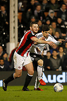 Rui Fonte of Fulham FC takes on Jack O'Connell of Sheffield United during the Sky Bet Championship match between Fulham and Sheff United at Craven Cottage, London, England on 6 March 2018. Photo by Carlton Myrie.