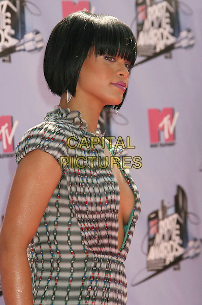 RIHANNA.2007 MTV Movie Awards held at the Gibson Amphitheater, Universal City, California, USA..June 3rd, 2007.half length dress black white grey gray pattern dress plunging neckline cleavage red blue green .CAP/ADM/RE.©Russ Elliot/AdMedia/Capital Pictures *** Local Caption *** ...