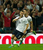 14.08.2013  London, England.        Englands Ricky Lambert celebrates scoring to make it 3-2 during the International match between England and Scotland,  From Wembley Stadium, London.