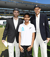 Captains Kane Willaimson and Joe Root with the ANZ coin toss winner.<br /> New Zealand Blackcaps v England. 1st day/night test match. Eden Park, Auckland, New Zealand. Day 1, Thursday 22 March 2018. &copy; Copyright Photo: Andrew Cornaga / www.Photosport.nz