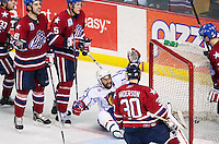 April 28, 2007; Hamilton, ON, CAN; Hamilton Bulldogs centre (32) Ajay Baines celebrates the third period goal by defenceman (2) Ryan O'Byrne (not pictured) as Rochester Americans players contest the goal in game six of the AHL north division semifinal at Copps Coliseum. The Bulldogs won 6-2 and eliminated the Americans from the playoffs. Mandatory Credit: Ron Scheffler, Special to the Spectator. (File number RRSA8327).