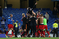 Huddersfield Town players celebrate at the end of the match by throwing their Manager, David Wagner into the air during Chelsea vs Huddersfield Town, Premier League Football at Stamford Bridge on 9th May 2018