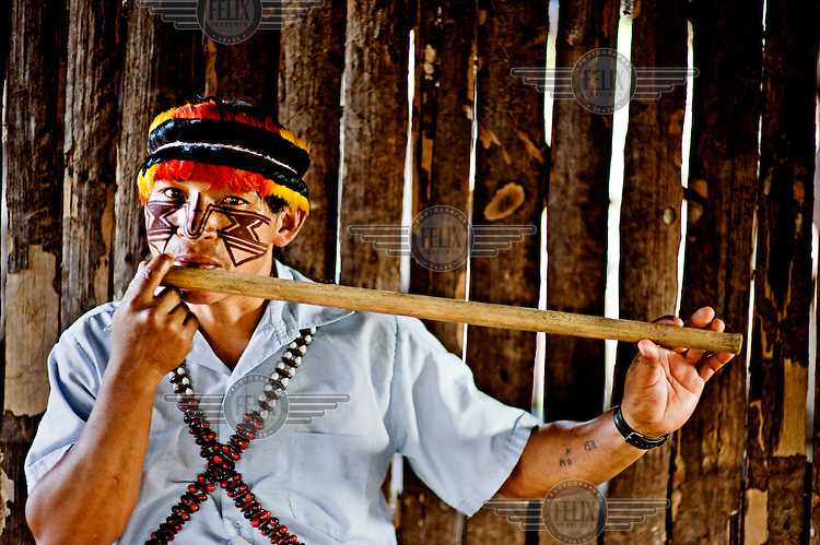 Achuar Adan Pitiur (Wampiu) playing an 'anent' on the flute (nanku). Anents are a kind of magic song used to bring fortune in all areas of life from warfare to love and everything in between.