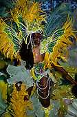 Rio de Janeiro, Brazil. Carnival: samba school sambista dancers with yellow and green butterfly feather costumes.