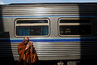 A Buddhist monk performs traditional greeting before boarding a heavily secured train in the troubled Yala province in southern Thailand February 28, 2011. Separatists are blamed for most of the attacks on Thailand's predominantly Muslim deep south, which often target Buddhists and Muslims associated with the Thai state, such as police, soldiers, government officials and teachers. No credible group has claimed responsibility for near daily drive-by shootings and bombings, which continue unabated, despite a massive counterinsurgency effort. Yala and Pattani are two of three Muslim-dominated provinces bordering Malaysia where more than 4,300 people, both Muslims and Buddhists, have been killed in a low-level insurgency since 2004.   REUTERS/Damir Sagolj (THAILAND)