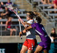 Laura Merrifield (9) of Maryland tries to get past Taylor Thornton (9) of Northwestern during the NCAA Championship held in Johnny Unitas Stadium at Towson University in Towson, MD.  Maryland defeated Northwestern, 13-11, to win the title.