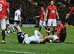 Preston's Joe Garner gets caught in the face off the ball by Manchester United's Marcos Rojo<br /> <br /> FA Cup - Preston North End vs Manchester United  - Deepdale - England - 16th February 2015 - Picture David Klein/Sportimage