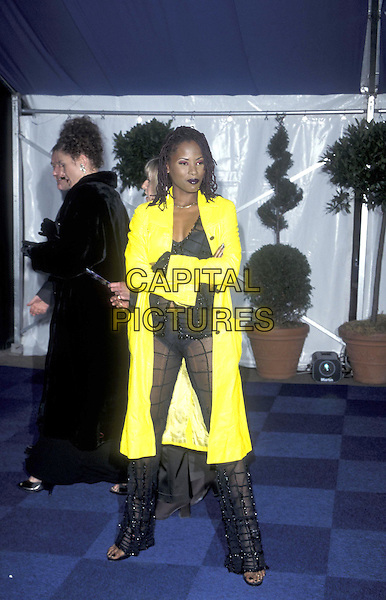 DENI HINES.09 February 1998.full legnth full-length bright yellow mac coat .ref:7063.www.capitalpictures.com.sales@capitalpictures.com.©Capital Pictures