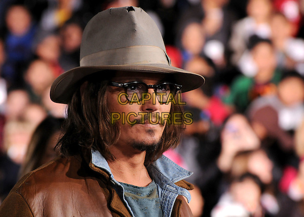 "JOHNNY DEPP.""Rango"" Los Angeles Premiere held at the Regency Village Theater, Westwood, California, USA..February 14th, 2011.headshot portrait glasses beige grey gray hat brown leather goatee facial hair .CAP/ADM/BP.©Byron Purvis/AdMedia/Capital Pictures."