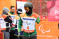 Day 7 / Snowboard banked SL. / Sean Pollard  (AUS)<br /> PyeongChang 2018 Paralympic Games<br /> Australian Paralympic Committee<br /> PyeongChang South Kore<br /> Friday March 16th 2018<br /> © Sport the library / Jeff Crow