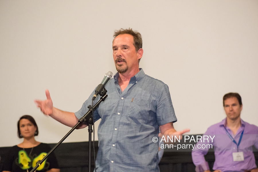 """Bellmore, New York, USA. 19th July 2017. Comedian LOU DIMAGGIO, at center, speaks during a Q&A at the Long Island International Film Expo LIIFE 2017. Immediately before that was the screening of the Documentary feature film """"Where Have You Gone, Lou DiMaggio?"""" about DiMaggio contemplating a comeback after being away from the stage for 20 years. Behind him are two of the other fillmmakers whose films were screened that night."""