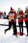 HOLMENKOLLEN, OSLO, NORWAY - March 17: Justyna Kowalczyk of Poland (POL) celebrates her 2nd place during the prize giving ceremony of the Ladies 30 km mass start race, free technique, at the FIS Cross Country World Cup on March 17, 2013 in Oslo, Norway.  (Photo by Dirk Markgraf).