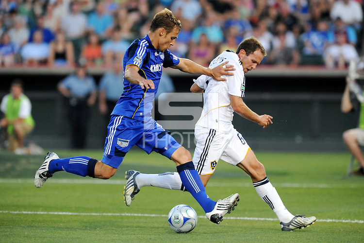 Aaron Hohlbein (blue), Eddie Lewis..Kansas City Wizards tied 1-1 with LA Galaxy at Community America Ballpark, Kansas City, Kansas.