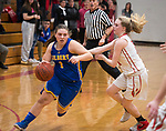 WINSTED,  CT-021919JS13-  Gilbert's Jillian Wexler (1) drives to the basket while being defended by Northwestern's Skylar Dimartino (11) during their Berkshire League semi-final game Tuesday at Northwestern Regional High School in Winsted. <br /> Jim Shannon Republican American