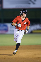 Bradley Strong (18) of the Kannapolis Intimidators blows a bubble as he rounds the bases after hitting a solo home run against the Hagerstown Suns at Kannapolis Intimidators Stadium on July 4, 2016 in Kannapolis, North Carolina.  The Intimidators defeated the Suns 8-2.  (Brian Westerholt/Four Seam Images)
