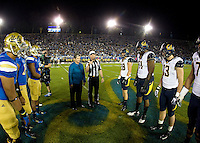 California and UCLA captains watch referee Shawn Hochuli tosses the coin during coin toss ceremony before the game at Rose Bowl in Pasadena, California on October 12th, 2013.   UCLA defeated California, 37-10.