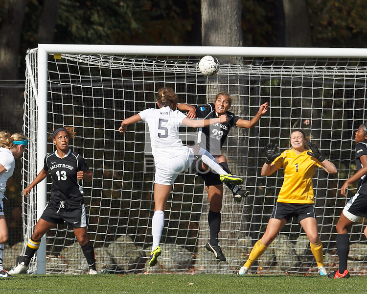 Kendra Bonczar scoring with a header.Manchester, New Hampshire - October 11, 2014: NCAA Division II. Saint Anselm College (white) defeated College of St. Rose (black), 2-0, on Melucci Field at Saint Anselm College.