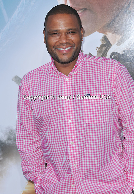 Anthony Anderson   arriving Elysium Premiere at the Westwood Village Theatre In Los Angeles.