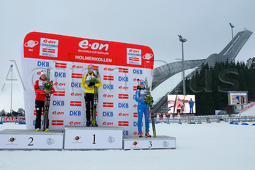 22.03.2014 Oslo Norway E.ON IBU World Cup Biathlon 2014 L - R  Tora Berger of Norway second place, first place Anastasiya Kuzmina of Slovakia, and Olga Vilukhina of Russia third place celebrates at the podium, during the IBU World Cup Biathlon ladies 10 kilometre pursuit  at the Holmenkollen in Oslo, Norway