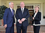 Australian Prime Minister Malcolm Turnbull (L) prepares for official photographs with Governor General Sir Peter Cosgrove (C) and Foreign Minister Julie Bishop (R) at Government House, Canberra on September 15, 2015. Photographer: Mark Graham/Bloomberg