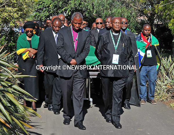 Qunu, South Africa: 14.12.2013: NELSON MANDELA BODY RETURNS TO QUNU<br /> ANC Leadership led by Deputy President Cyril Ramaphosa, National Chairperson Baleka Mbete, Secretary General Gwede Mantashe and Treasurer General Dr Zweli Mkhize were pallbearers as they took over from the Army. ANC Chaplain Reverend Mehana and Archbishop Mokgoba lead the procession. <br /> The former President of South Africa Nelson Mandela will be buried in a private ceremony on Sunday 15th December 2013 in Qunu.<br /> Mandatory Credit Photo: &copy;Jiyane-GCIS/NEWSPIX INTERNATIONAL<br /> <br /> **ALL FEES PAYABLE TO: &quot;NEWSPIX INTERNATIONAL&quot;**<br /> <br /> IMMEDIATE CONFIRMATION OF USAGE REQUIRED:<br /> Newspix International, 31 Chinnery Hill, Bishop's Stortford, ENGLAND CM23 3PS<br /> Tel:+441279 324672  ; Fax: +441279656877<br /> Mobile:  07775681153<br /> e-mail: info@newspixinternational.co.uk