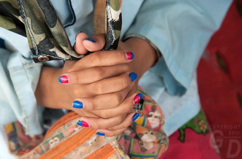 Hand and colour fingernails, Cambodia. Thai-Cambodia border crossing