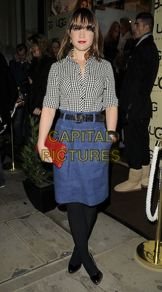 SCARLETT JOHNSON.The UGG Australia: London Store Launch in Covent Garden, London, England. .November 26th, 2008 .full length jean denim blue skirt grey gray top black tights red clutch bag hand in pocket .CAP/CAN.©Can Nguyen/Capital Pictures.