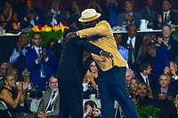 Canton, Ohio - August 2, 2019:  Ed Reed receives his Hall of Fame Gold Jacket from his father at the Canton Civic Center in Canton, Ohio August 2, 2019.  (Photo by Don Baxter/Media Images International)