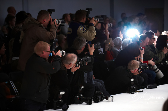 Photographers at the catwalk during &quot;Designers Nest Show and Award&quot;. The fashion fair &quot;CPH Vision&quot; in Oksnehallen during Copenhagen Fashion Week.<br /> February 2009.<br /> Only for editorial use.