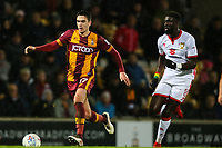 Alex Gilliead of Bradford City chased by Ousseynou Cisse  of MK Dons during the Sky Bet League 1 match between Bradford City and MK Dons at the Northern Commercial Stadium, Bradford, England on 24 April 2018. Photo by Thomas Gadd.
