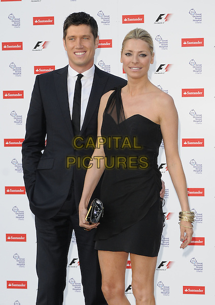 VERNON KAY & TESS DALY .The F1 Party held at the Natural History Museum, London, England, UK..5th July 2010.Formula one half 3/4 length black sheer one shoulder dress clutch bag suit tie white shirt married husband wife  .CAP/CAN.©Can Nguyen/Capital Pictures.