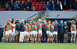 The Clooney-Quin stand for the anthem before their senior county final replay against Sixmilebridge at Cusack park. Photograph by John Kelly.