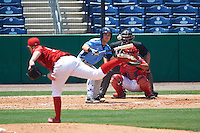 Charlotte Stone Crabs designated hitter Jace Conrad (19) bunts a pitch from Tom Eshelman (39) while at bat in front of catcher Chace Numata (50) and umpire Mike Savakinas during a game against the Clearwater Threshers on April 13, 2016 at Bright House Field in Clearwater, Florida.  Charlotte defeated Clearwater 1-0.  (Mike Janes/Four Seam Images)